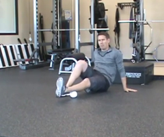A sports performance specialist demonstrates calf stretches.