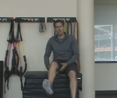 A sports performance specialist demonstrates hamstring stretches.