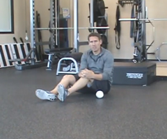 A sports performance specialist demonstrates hip stretches.