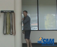 A sports performance specialist demonstrates shoulder stretches.