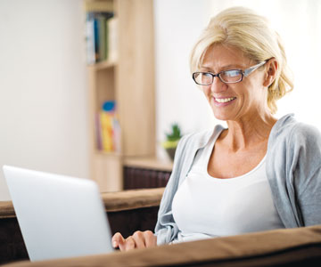 Smiling woman sitting with laptop