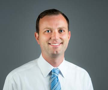Head shot of Adam Brady, MD