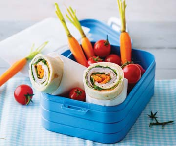 Wraps and veggies in blue lunch container