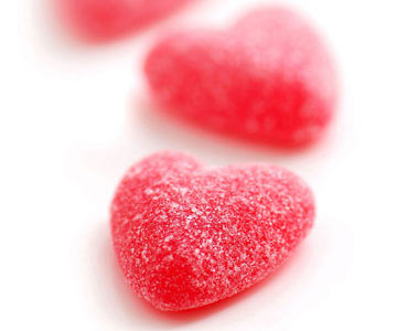 Red candy hearts with sugar coating
