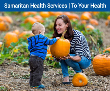 Mom and toddler in a pumpkin patch together- To Your Health banner.