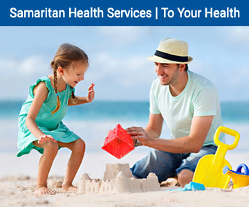 Father and young daughter building a sand castle. To Your Health E-news - Samaritan Health Services.