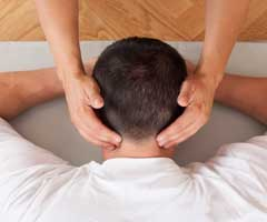 Man face down getting neck massage or acupressure
