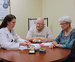 Senior couple meeting with provider