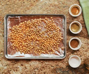 Spicy baked chickpeas are a healthy snack.