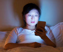 Using electronic devices in bed can delay sleep and disrupt sleeping patterns.