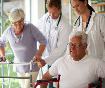 doctors-helping-patient-walker-wheelchair-001-CO