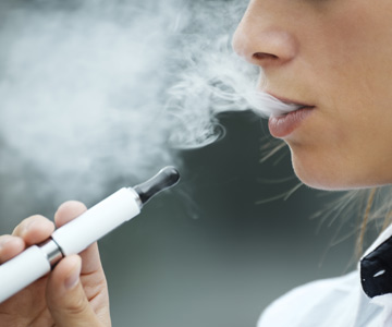 Woman using a vaping device.
