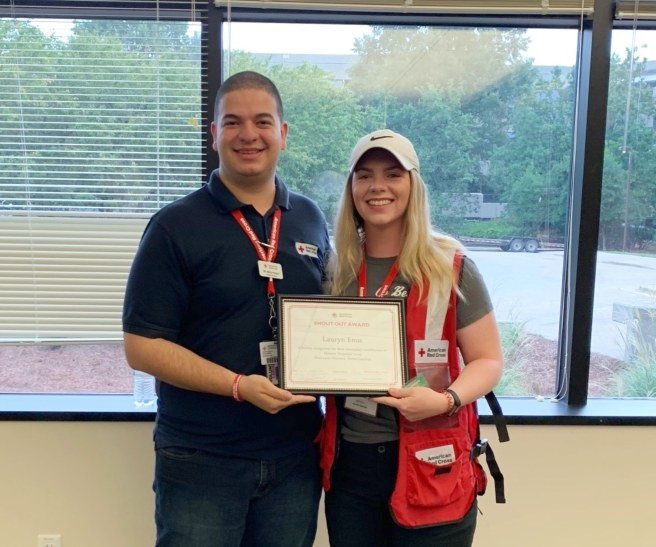 Lauryn Enos receives certificate from American Red Cross.