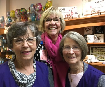 Suzette Boydston with volunteers Cleta Gannon and Bonnie Moore