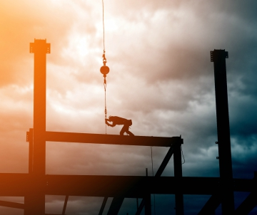Silhouette of steel beam and crane