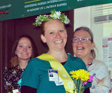 Crowned with a daisy tiara, Elaina Wilson, RN, receives the first DAISY award at Samaritan North Lincoln Hospital.
