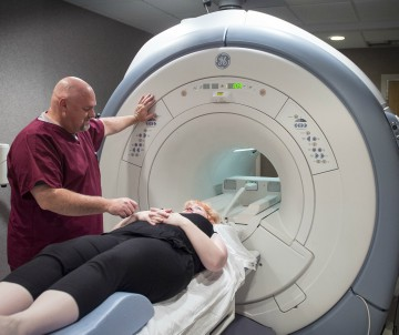 A female patient receives an MRI