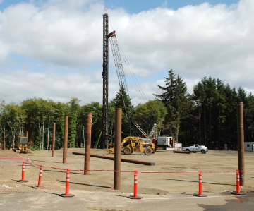 View of steel columns and pile driving crane