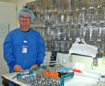 Gar Hills smiles as he stands in front of some of the tools of his trade