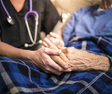 Nurse and elderly patient hands