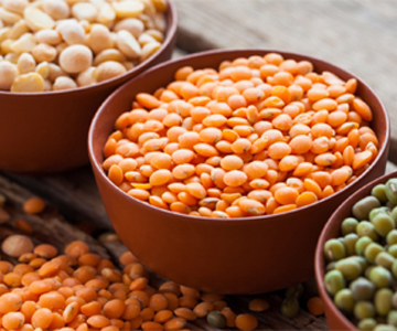 Three large bowls of legumes