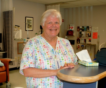 Kathy Van Hess stands at the nursing station inside of Ambulatory Infusion