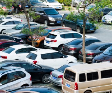 View of a parking lot full of vehicles taken from above