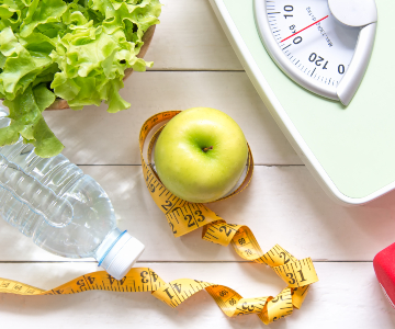 photo contains a collage of images...lettuce, bottled water, apple with measuring tape encircling it, scale