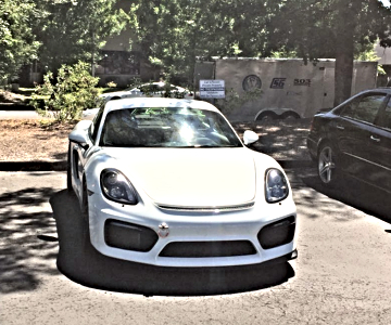 white Porsche car at a recent show