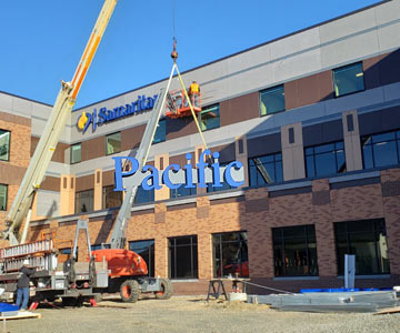 Signs going up on the new addition to the hospital in Newport.