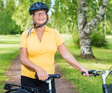 Woman wearing a biking helmet.
