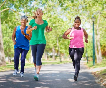 Women jogging on a sunny day.