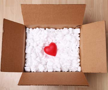 Red heart in a cardboard box.