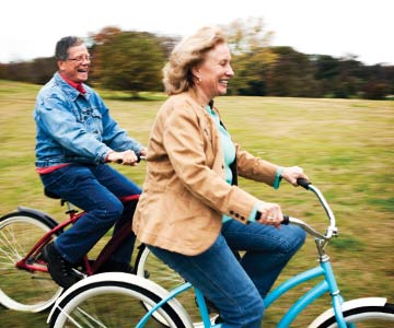 Man and woman riding cruiser bikes together.