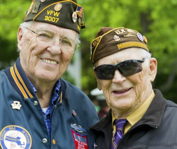 Two elderly white Korean War veterans wearing VFW regalia