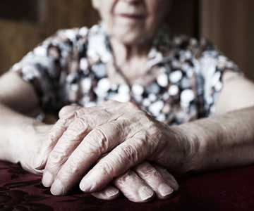 The elderly hands of a woman in the hospice house.