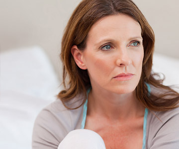 woman looking contemplative, pensive, depressed