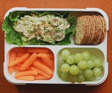 Avocado chicken salad in a bento box.