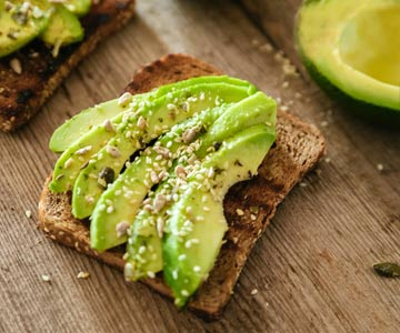 Avocado on whole wheat toast provides healthy fat and fiber.