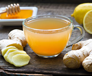 Hot tea with lemon, ginger and honey can be a helpful drink when you're under the weather.