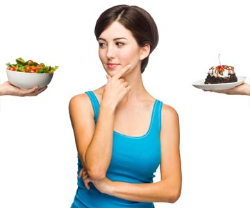 Woman contemplates her dietary options — salad or cake.