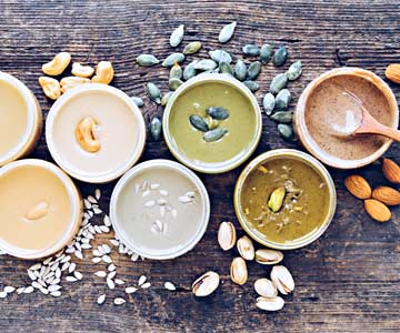 Various kinds of nut and seed butters including cashew, almond, sunflower, pumpkin and pistachio.