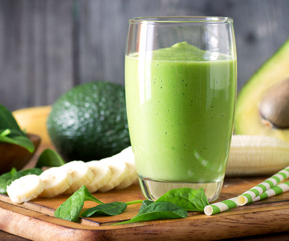 A refreshing green smoothie made with avocado, bananas, spinach and chia seeds.