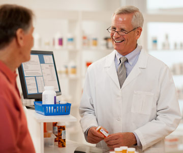 A patient consulting with his pharmacist.