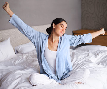 Woman stretching after just waking up.