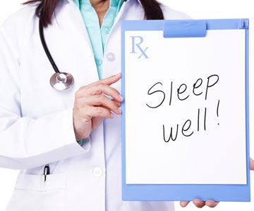 Doctor holding clipboard with sign that says Sleep Well!